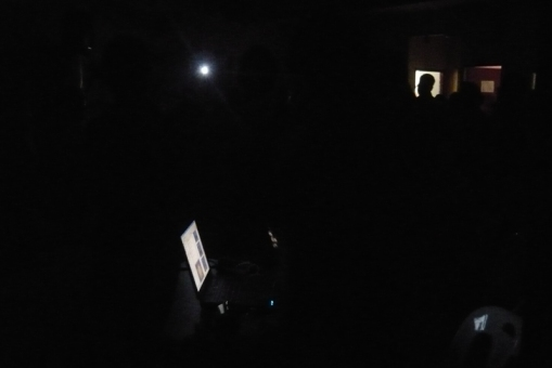 the hall was that dark. those are lights from the laptop, a phone and a small window.
