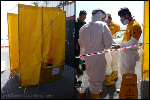 left: a place where they do personnel decon (ohno!! i forgot wat it's called will update once i got the correct info.) right: it was pretty hot and that white suits can never help. semakin lah panas!! but one thing i learned here was how to remove the suits + PPEs in minimum time.... yay!! isk, not that i like to wear the suits oso :p