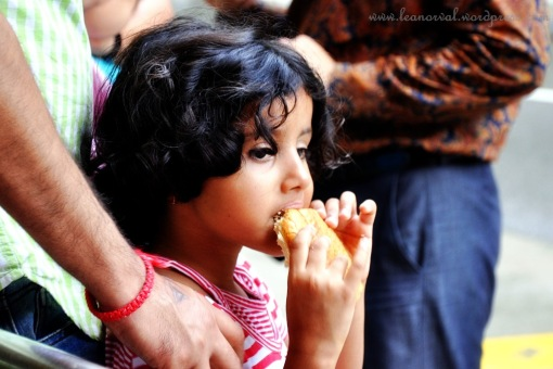 caught this little indian girl eating her bun, isn't she beautiful?!
